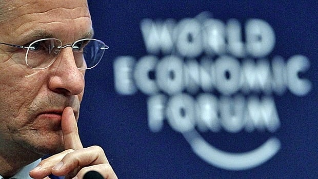 """Marks & Spencer Chief Executive Marc Bolland attends a session at the World Economic Forum in Davos last year. The financial body says the financial crisis could lead to a """"dystopian future"""" for much of humanity."""