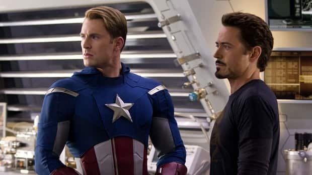 Chris Evans, left, as Captain America, and Robert Downey Jr., portraying Tony Stark, are shown in a scene from The Avengers. It's the year's biggest movie so far and a sequel is in the works.