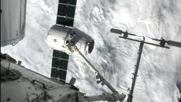 The SpaceX Dragon capsule docks with the international space station.