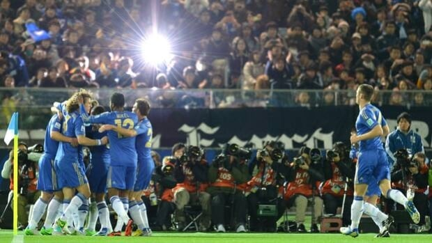 Juan Mata is mobbed by Chelsea teammates after opening the scoring in Thursday's 3-1 win.