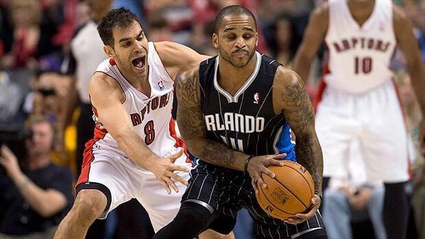 Toronto Raptors guard Jose Calderon guards Orlando Magic guard Jameer Nelson during first half action.
