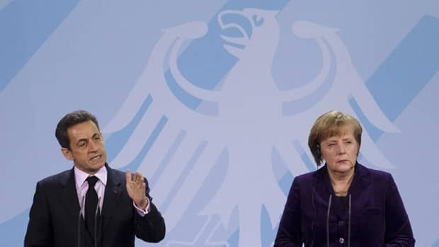 German Chancellor Angela Merkel, right, and French President Nicolas Sarkozy brief the media after talks about the euro debt crisis at the chancellery in Berlin on Monday.