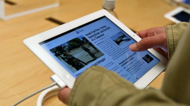 A customer works on the new iPad at a store in San Francisco.