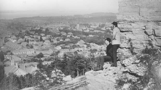 Two men look over the Hamilton cityscape from atop the Niagara Escarpment in 1888, a time when the city was known as the 'ambitious city.'