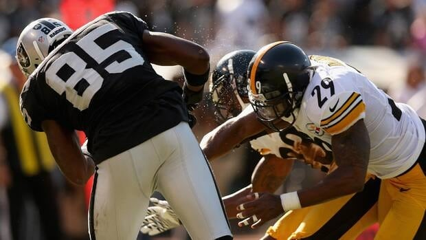 Raiders' Darrius Heyward-Bey is hit by Steelers' Ryan Mundy as he goes for a pass. Heyward-Bay had to be taken off the field on a strecher.