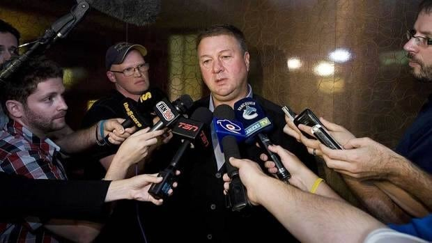 Vancouver GM Mike Gillis, centre, made perhaps the biggest splash on deadline day by dealing Cody Hodgson for Zack Kassian and adding Samuel Pahlsson.