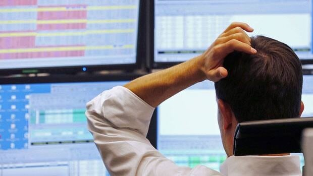 A trader watches his screens at the Frankfurt Stock Market earlier this month. The German benchmark stock index, the DAX, lost two per cent Wednesday.