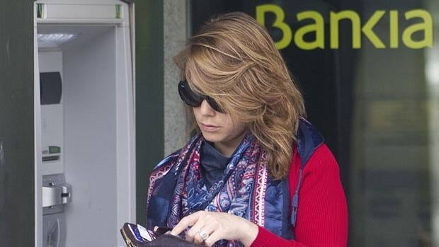 A woman uses a Bankia ATM in Madrid Thursday.