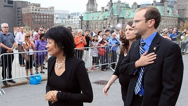 Jack Layton's widow, Olivia Chow, his son Mike and daughter Sarah, pictured while mingling with supporters lined up on Parliament Hill to pay their respects to Layton, who died Aug. 22, 2011.