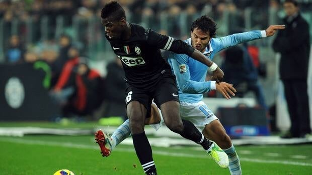 Paul Pogba of Juventus, left, is challenged by Alvaro Gonzalez of Lazio during the match at Juventus Arena on November 17, 2012 in Turin, Italy.