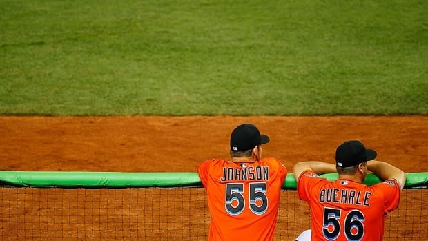 Josh Johnson and Mark Buehrle look on during a game against the New York Yankees at Marlins Park last season. Reports say the pitchers are on their way to Toronto.