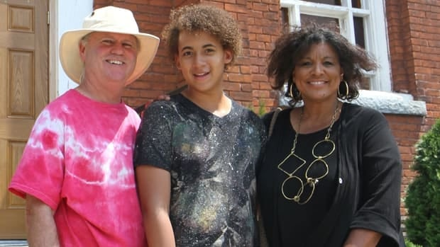 Jackson Holland (centre) with his grandparents, Alan Smith and Nerene Virgin outside of the Stewart Memorial Church.