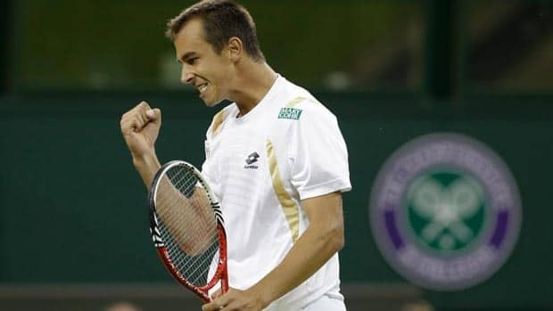 Lukas Rosol of the Czech Republic reacts during a second round men's singles match against Rafael Nadal of Spain at the All England Lawn Tennis Championships at Wimbledon, England, Thursday, June 28, 2012. (AP Photo/Anja Niedringhaus)