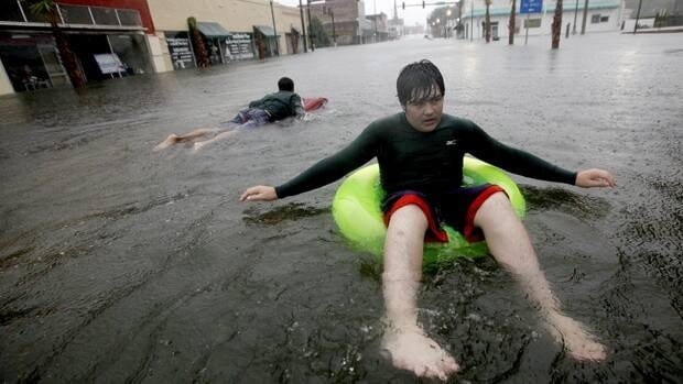 Austin Tinker floats on flood waters from Tropical Storm Debby in downtown Live Oak, Fla.