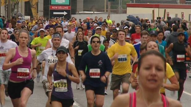 Runners take part in last year's Yonge Street 10K. The annual run will close much of Yonge Street and other downtown routes on Sunday.