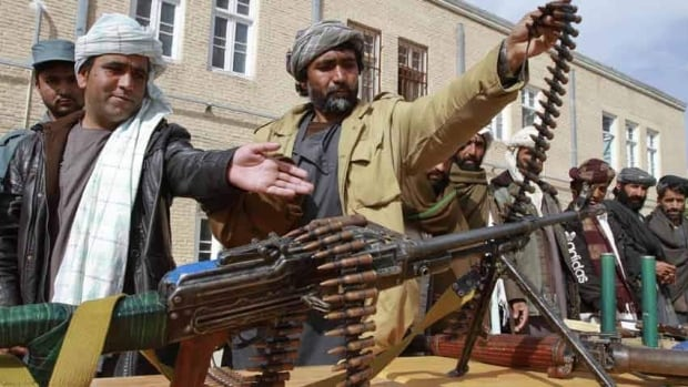 Former Afghan Taliban members hand over their weapons after joining the Afghan government's reconciliation and reintegration program. The Taliban and the government of Afghan President Hamid Karzai are looking to jumpstart the country's troubled peace process.