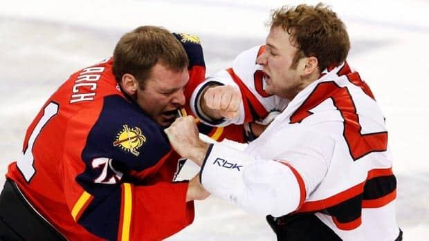Krys Barch, left, fights with New Jersey Devils forward Cam Janssen in a 2011-12 game.