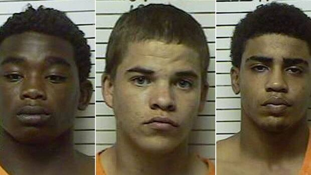 James Francis Edwards Jr., 15, left, and Chancey Allen Luna, 16, far right were charged with first-degree murder Tuesday in the killing of 22-year-old Australian collegiate baseball player Christopher Lane in Duncan, Okla. Michael Dewayne Jones, 17, centre, was charged with using a vehicle in the discharge of a weapon and accessory to first-degree murder. All three boys will be tried in adult court.