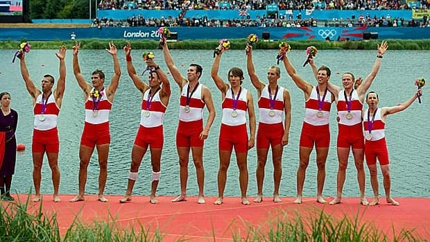 Canada's men's eight rowing team members Gabriel Bergen, left to right Douglas Csima, Rob Gibson, Conlin McCabe, Malcolm Howard, Andrew Byrnes, Jeremiah Brown, Will Crothers, and cox Brian Price celebrate their silver medal at Eton Dorney during the 2012 Summer Olympics in Dorney, England on Wednesday, August 1, 2012.