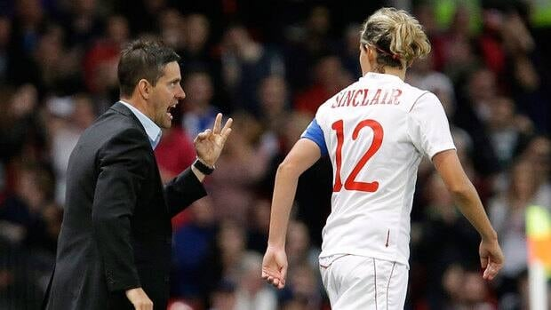 Coach John Herdman, left, and star forward Christine Sinclair were both critical of the officiating in Canada's semifinal loss to the U.S.