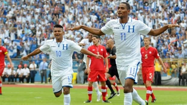 Jerry Bengtson, right, celebrates followed by Honduran teammate Mario Martinez after scoring against Canada in San Pedro Sula on Tuesday.