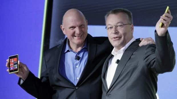 Microsoft CEO Steve Ballmer, left, and Nokia CEO Stephen Elop, introduce Nokia's newest smartphone, the Lumia 920, which runs on Microsoft's Windows Phone 8 operating system, in New York Wednesday.