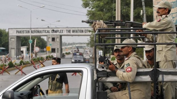 Paramilitary soldiers guard near the main entrance of the Minhas in the town of Kamra in Punjab province.