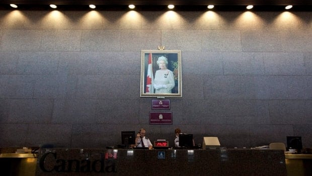 A portrait of the Queen hangs on the Sovereign's Wall at the entrance to the Department of Foreign Affairs in Ottawa.