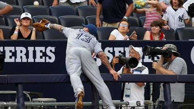 Toronto Blue Jays third baseman Brett Lawrie misses a foul ball during the third inning of a against the New York Yankees  on Wednesday at Yankee Stadium in New York.