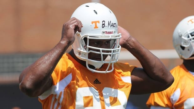 Ben Martin, who played for Tennessee from 2007-2011, is one of the three players that filed a class-action lawsuit in federal court in Chattanooga, Tenn., on Wednesday.