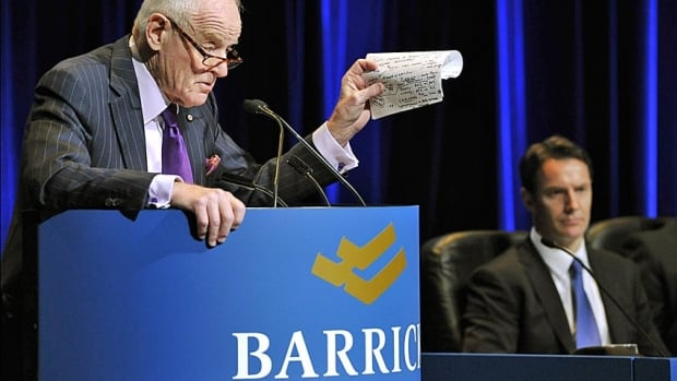 Peter Munk is shown in the foreground in front of former CEO Aaron Regent at Barrick's recent AGM.