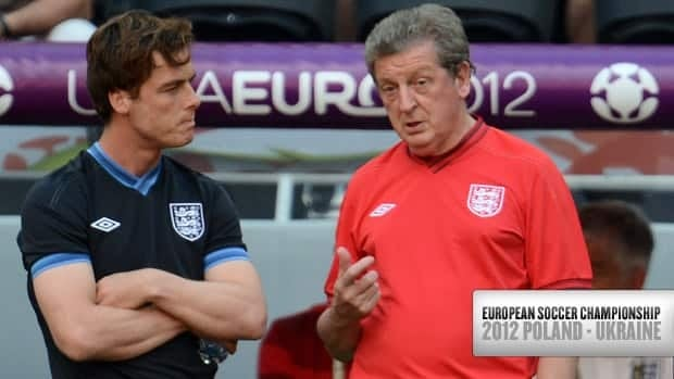 England head coach Roy Hodgson, right, speaks with midfielder Scott Parker during a training session at the Dombass Arena stadium in Donetsk on June 10 , 2012.