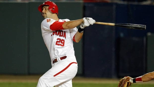 Canada's Jimmy Van Ostrand, shown in this 2011 file photo, hit two home runs in his team's 16-7 win over Germany on Saturday.