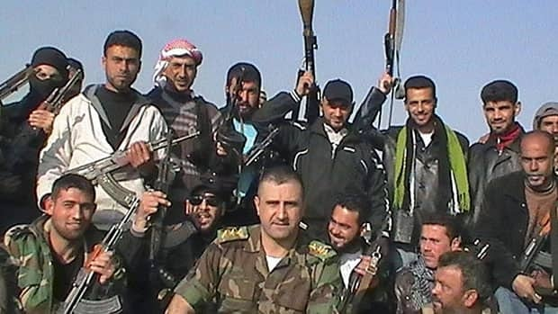 Syrian soldiers who defected to join the Free Syrian Army are seen among demonstrators in the northern town of Kafranbel on Jan. 29, 2012.