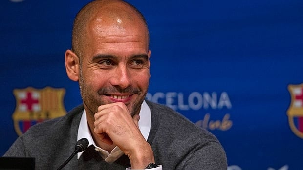 Barcelona's coach Pep Guardiola smiles during a press conference where he announced his resignation on Friday.