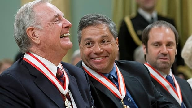 Peter Singer (centre), Jeffrey Skoll (right) and former prime minister Paul Martin were invested as officers and companion respectively, during Order of Canada ceremonies on Friday.