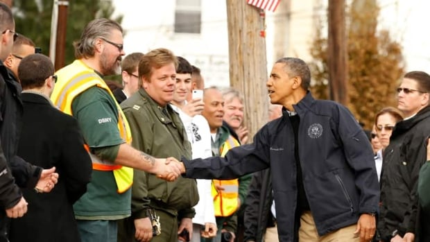 U.S. President Barack Obama shakes hands during a visit to a hurricane battered Staten Island neighborhood in New York. Obama announced Housing and Urban Development Secretary will oversee long-term rebuilding in the region.