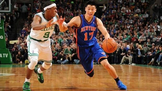 Jeremy Lin, right, of the New York Knicks drives the ball against Rajon Rondo, left, of the Boston Celtics on during their game Sunday at TD Gardens. Rondo had a triple-double in the Celtics overtime victory.