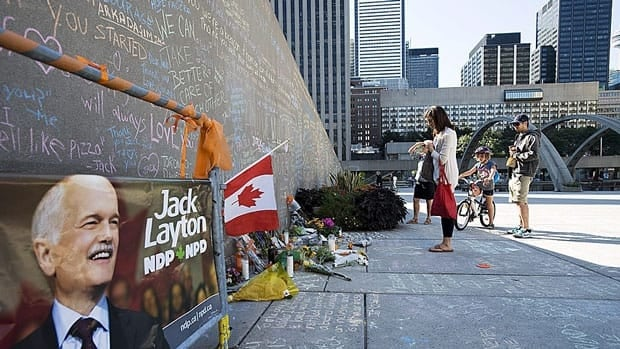 Chalk messages and other tributes were on display for several days at Toronto's Nathan Phillips Square after former NDP leader Jack Layton's death on August 22, 2011. The public space will host a gathering this Wednesday to mark the one-year anniversary.