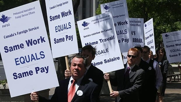 Striking foreign service workers picket in front of the Canadian embassy in Washington, D.C., in May.