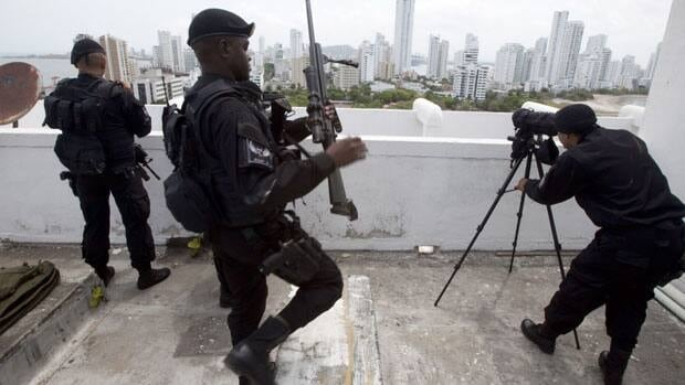 Colombian special forces troops take position on the roof of a building in Cartagena in preparations for the sixth Summit of the Americas.