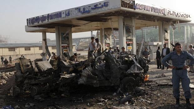 Afghan security personnel investigate at the site of a suicide attack in Kabul which killed at least nine people and injured 10 others on Tuesday.