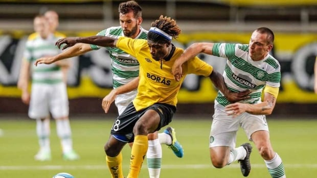 Mohamed Bangura, centre, fights for the ball with Glasgow Celtic's Charlie Mulgrew, left, and Scott Brown during their UEFA Champions League qualification match in Boras, Sweden, on Wednesday.