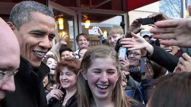 U.S. President Barack Obama greets citizens after visiting One More Page Books store in Arlington, Va., on Saturday. Obama is reaching out to different groups as he tries to find a solution to the country's looming debt problems.