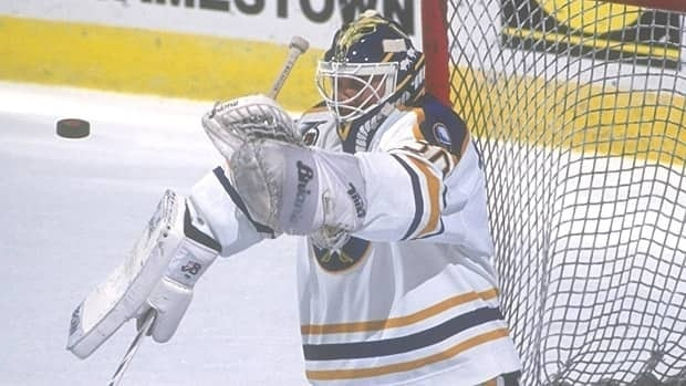 Clint Malarchuk, seen with Buffalo in 1990, played in 338 NHL games. He struggled with PTSD after an errant skate slashed his jugular vein during an NHL game in 1989.