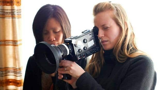 Stories We Tell follows Sarah Polley, seen at right with her director of cinematography, Iris Ng, tracking the story of her parentage.