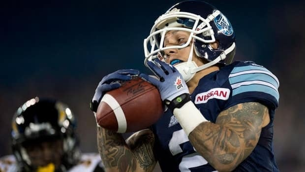 Toronto Argonauts wide receiver Chad Owens hauls in a pass against the Hamilton Tiger-Cats Thursday en route to setting the all-time yards record.