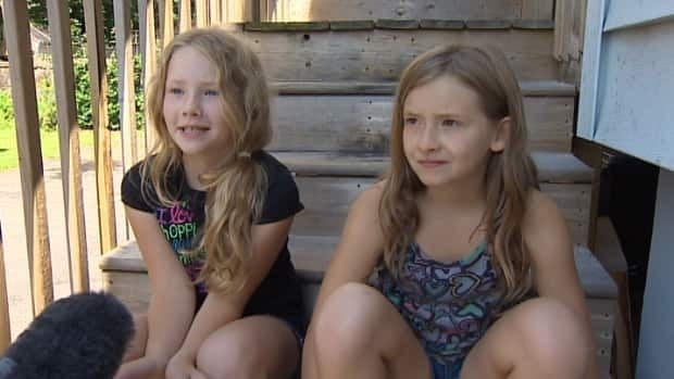 Jaime Hatt and her two daughters are using the Parker Street Food and Furniture Bank until their items are returned.