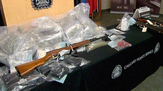 Calgary police display items seized in a month-long investigation in southeast Calgary.