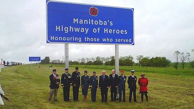 A sign marking Manitoba's Highway of Heroes is unveiled Friday near St. Francois Xavier on the Trans-Canada Highway.